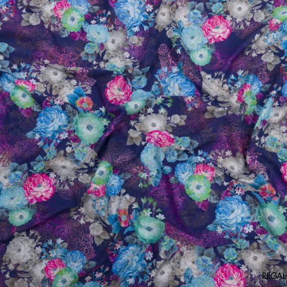 Purple brocade fabric with blue, pink, gold printed floral design