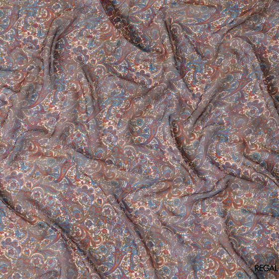 Off white silk chiffon fabric with red, light rust, blue and olive green print in paisley design
