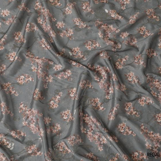 Forest green synthetic crepe fabric with beige and print in floral design having gold sequins